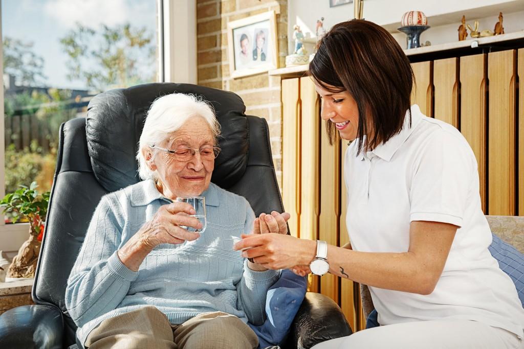Nurse caring for elderly person